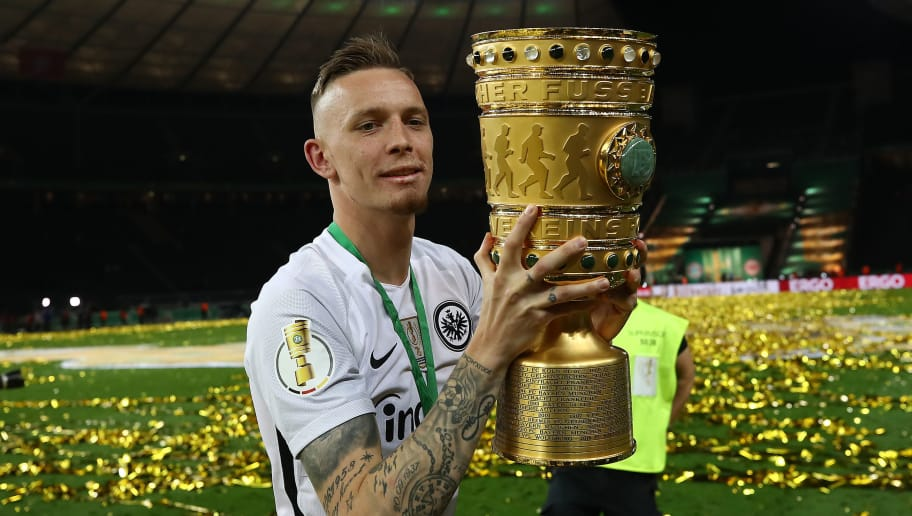 BERLIN, GERMANY - MAY 19: Marius Wolf of Frankfurt holds the trophy and celebrates after the DFB Cup final between Bayern Muenchen and Eintracht Frankfurt at Olympiastadion on May 19, 2018 in Berlin, Germany. (Photo by Maja Hitij/Bongarts/Getty Images)