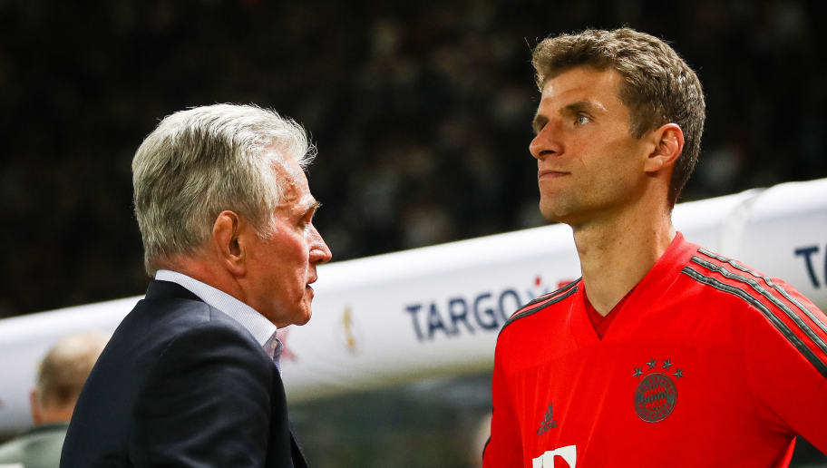 BERLIN, GERMANY - MAY 19: Head Coach Jupp Heynckes of FC Bayern Muenchen  and Thomas Muller #25 of FC Bayern Muenchen react after the DFB Cup final between Bayern Muenchen and Eintracht Frankfurt at Olympiastadion on May 19, 2018 in Berlin, Germany. (Photo by Maja Hitij/Bongarts/Getty Images)