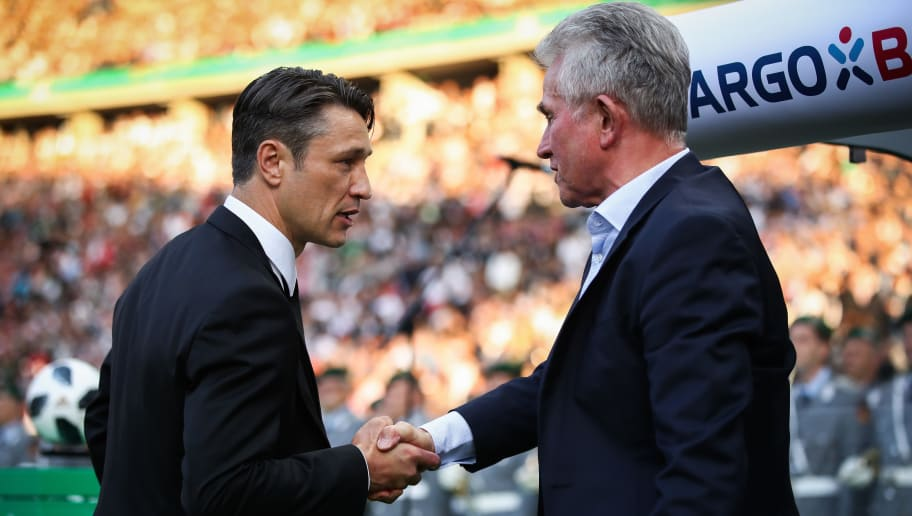 BERLIN, GERMANY - MAY 19: Coach Niko Kovac of Frankfurt (L) greets Jupp Heynckes, head coach of Bayern Muechen, prior to the DFB Cup final between Bayern Muenchen and Eintracht Frankfurt at Olympiastadion on May 19, 2018 in Berlin, Germany. (Photo by Maja Hitij/Bongarts/Getty Images)