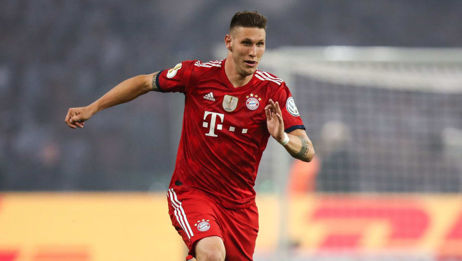 BERLIN, GERMANY - MAY 19: Niklas Sule #4 of FC Bayern Muenchen controls the ball during the DFB Cup final between Bayern Muenchen and Eintracht Frankfurt at Olympiastadion on May 19, 2018 in Berlin, Germany. (Photo by Maja Hitij/Bongarts/Getty Images)
