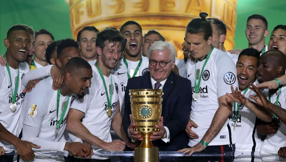BERLIN, GERMANY - MAY 19: German President Federal President Frank-Walter Steinmeier hands over the trophy to team Captain David Abrahm and Alexander Meier during the DFB Cup final between Bayern Muenchen and Eintracht Frankfurt at Olympiastadion on May 19, 2018 in Berlin, Germany.  (Photo by Lars Baron/Bongarts/Getty Images)