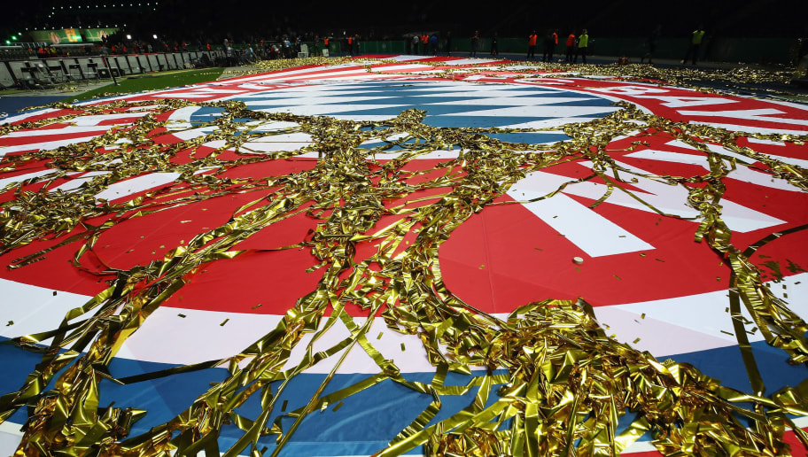 BERLIN, GERMANY - MAY 19: Lametta lies on the Bayern Muenchen logo after the DFB Cup final between Bayern Muenchen and Eintracht Frankfurt at Olympiastadion on May 19, 2018 in Berlin, Germany.  (Photo by Alex Grimm/Bongarts/Getty Images)