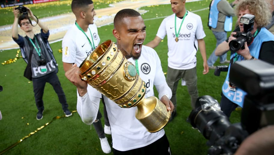 BERLIN, GERMANY - MAY 19:  Kevin Prince Boateng celebrates with the DFB Cup trophy after winning the DFB Cup final against Bayern Muenchen at Olympiastadion on May 19, 2018 in Berlin, Germany.  (Photo by Lars Baron/Bongarts/Getty Images)