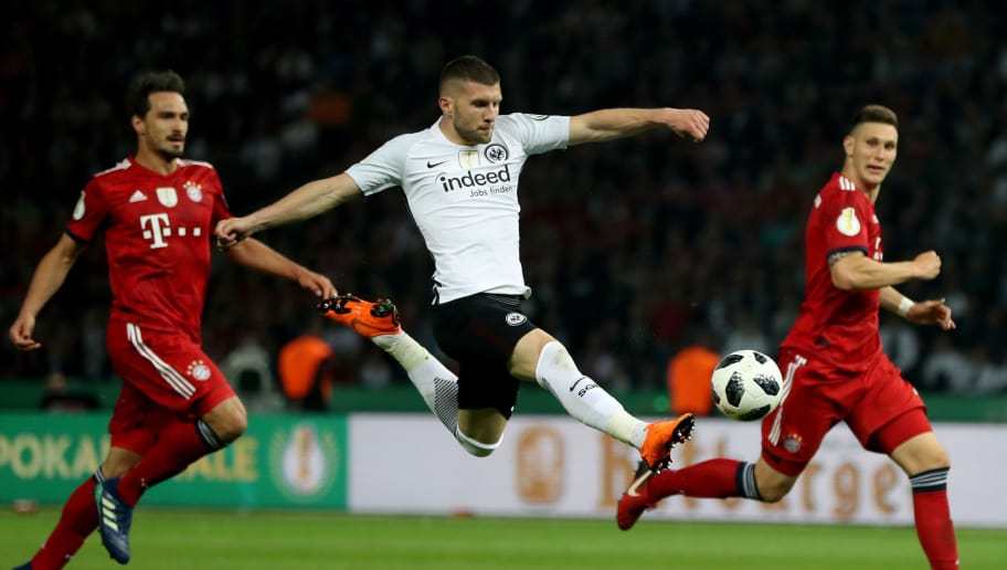BERLIN, GERMANY - MAY 19: Ante Rebic of Frankfurt scores his teams second goal next to Mats Hummels of Bayern Muenchen and Niklas Suele of Bayern during the DFB Cup final between Bayern Muenchen and Eintracht Frankfurt at Olympiastadion on May 19, 2018 in Berlin, Germany.  (Photo by Lars Baron/Bongarts/Getty Images)