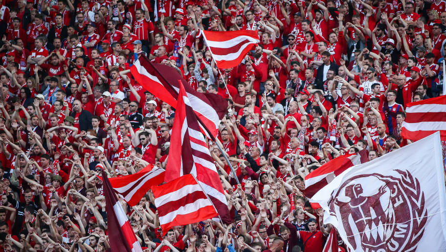 BERLIN, GERMANY - MAY 19: Fans of Bayern Muenchenwave flags prior to the DFB Cup final between Bayern Muenchen and Eintracht Frankfurt at Olympiastadion on May 19, 2018 in Berlin, Germany. (Photo by Maja Hitij/Bongarts/Getty Images)