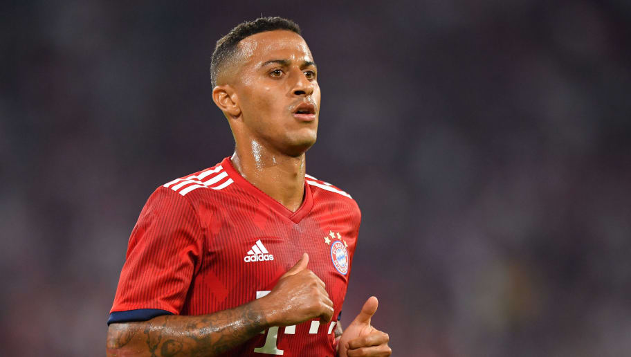 MUNICH, GERMANY - AUGUST 05: Thiago Alcantara of Bayern Muenchen plays the ball during the friendly match between Bayern Muenchen and Manchester United at Allianz Arena on August 5, 2018 in Munich, Germany. (Photo by Sebastian Widmann/Bongarts/Getty Images)