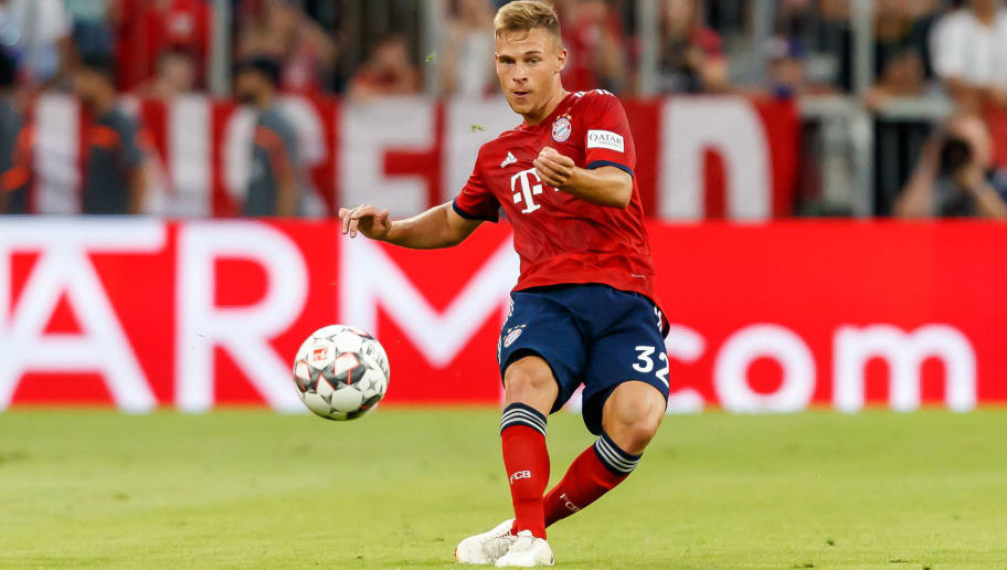 MUNICH, GERMANY - AUGUST 05: Joshua Kimmich of Bayern Muenchen controls the ball during the friendly match between Bayern Muenchen and Manchester United at Allianz Arena on August 5, 2018 in Munich, Germany. (Photo by TF-Images/Getty Images)