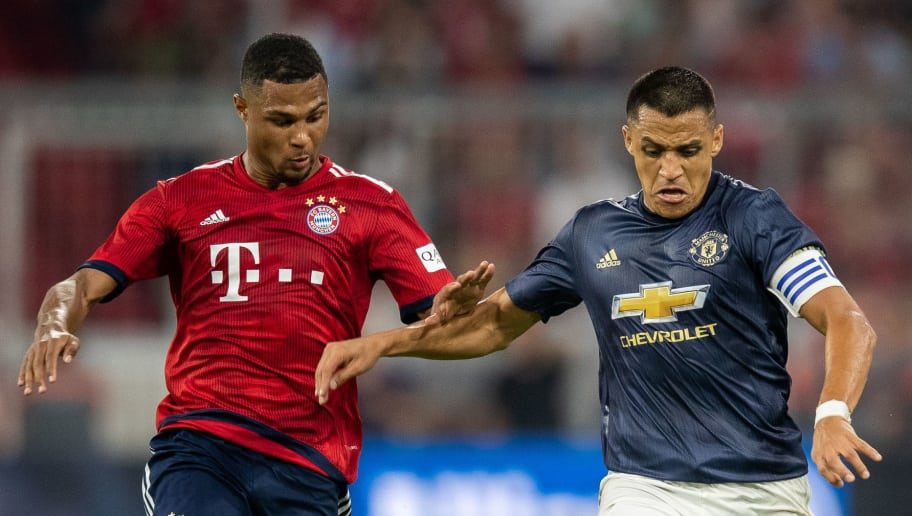 MUNICH, GERMANY - AUGUST 05: Alexis Sanchez of Manchester United is challenged by Serge Gnabry of FC Bayern Muenchen during the friendly match between Bayern Muenchen and Manchester United at Allianz Arena on August 5, 2018 in Munich, Germany. (Photo by Boris Streubel/Getty Images)