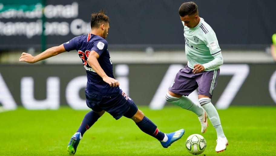 KLAGENFURT, AUSTRIA - JULY 21: Azzedine Toufiqui of Paris St. Germain and Oliver Batista Meier of FC Bayern Muenchen during the AUDI Football Summit match between Bayern Muenchen and Paris St. Germain at Woerthersee Stadion on July 21, 2018 in Klagenfurt, Austria. (Photo by Josef Bollwein - Sepa Media/Bongarts/Getty Images)