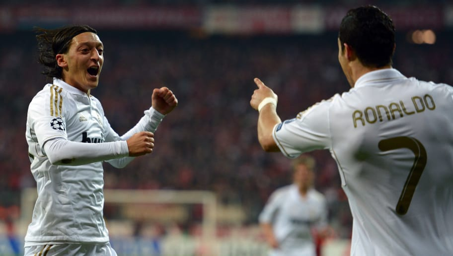 MUNICH, GERMANY - APRIL 17:  Mesut Oezil of Madrid celebrates with team mate Cristiano Ronaldo after scoring his teams first goal during the UEFA Champoins League Semi Final first leg match between FC Bayern Muenchen and Real Madrid at Allianz Arena on April 17, 2012 in Munich, Germany.  (Photo by Lars Baron/Bongarts/Getty Images)