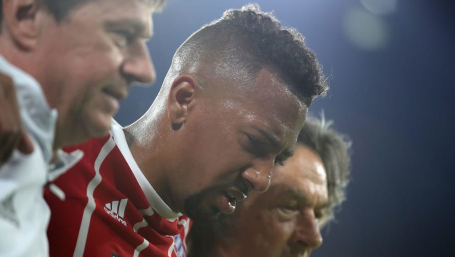 MUNICH, GERMANY - APRIL 25:  Jerome Boateng of Bayern Muenchen leaves the pitch in pain due to an injury during the UEFA Champions League Semi Final First Leg match between Bayern Muenchen and Real Madrid at the Allianz Arena on April 25, 2018 in Munich, Germany.  (Photo by Alexander Hassenstein/Bongarts/Getty Images)