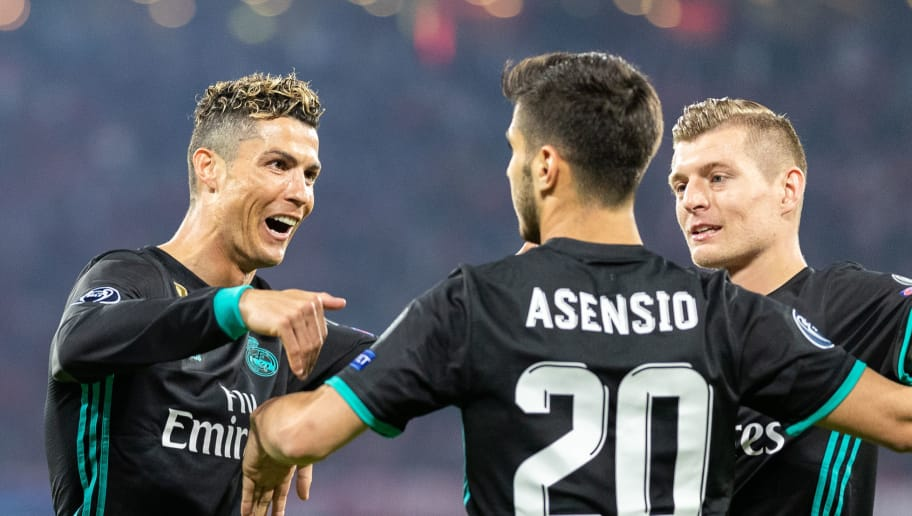 MUNICH, GERMANY - APRIL 25: Marco Asensio of Real Madrid celebrates with team mates after scoring his team's second goal during the UEFA Champions League Semi Final First Leg match between Bayern Muenchen and Real Madrid at the Allianz Arena on April 25, 2018 in Munich, Germany. (Photo by Boris Streubel/Getty Images)