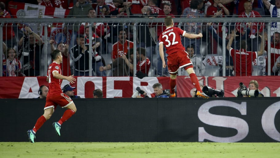 MUNICH, GERMANY - APRIL 25: Joshua Kimmich of Bayern Munich celebrates his goal with Robert Lewandowski (left) during the UEFA Champions League Semi Final first leg match between Bayern Muenchen (Bayern Munich) and Real Madrid at the Allianz Arena on April 25, 2018 in Munich, Germany. (Photo by Jean Catuffe/Getty Images)
