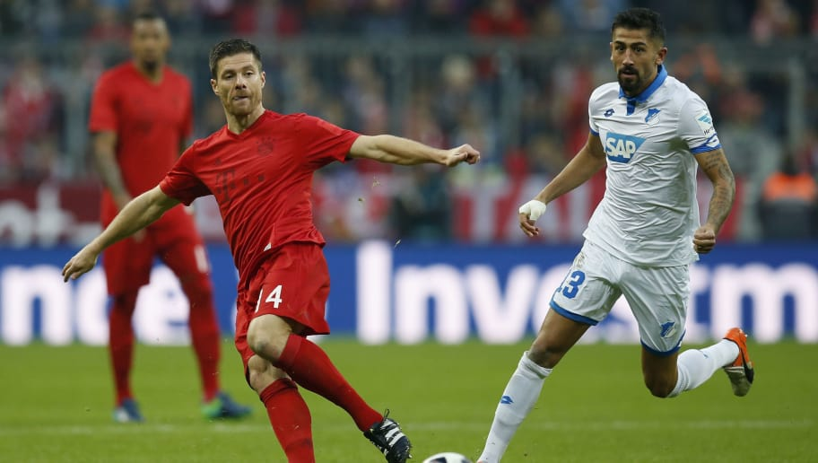 MUNICH, GERMANY - NOVEMBER 05:  Xabi Alonso of FC Bayern Muenchen is challenged by Kerem Demirbay of TSG Hoffenheim during the Bundesliga match between Bayern Muenchen and TSG 1899 Hoffenheim at Allianz Arena on November 5, 2016 in Munich, Germany.  (Photo by Boris Streubel/Getty Images)