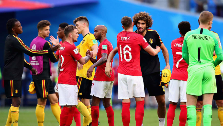 SAINT PETERSBURG, RUSSIA - JULY 14: Phil Jones of England hugs Marouane Fellaini of Belgium after the 2018 FIFA World Cup Russia 3rd Place Playoff match between Belgium and England at Saint Petersburg Stadium on July 14, 2018 in Saint Petersburg, Russia.  (Photo by Chris Brunskill/Fantasista/Getty Images)