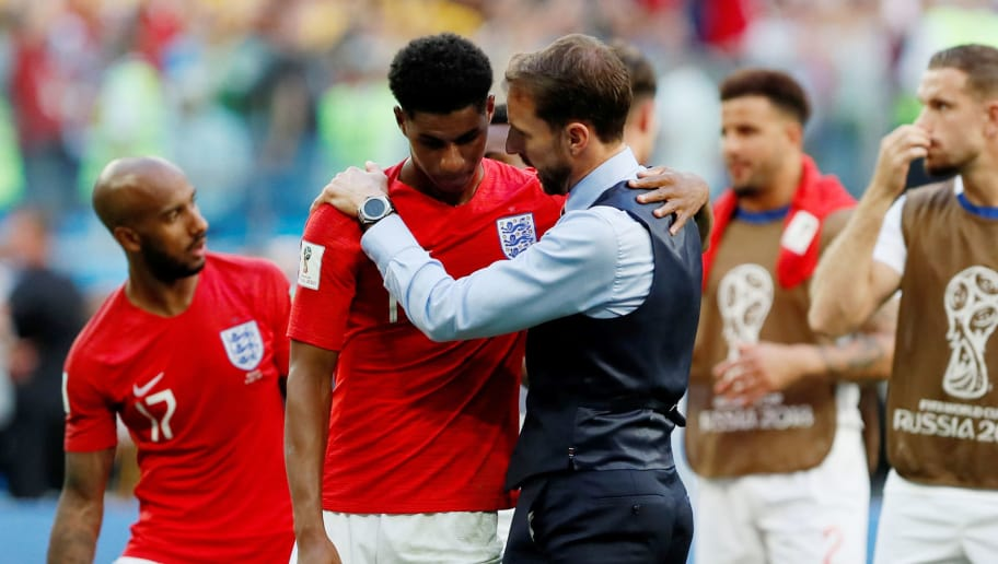 SAINT PETERSBURG, RUSSIA - JULY 14: England head coach Gareth Southgate (3rd R) talks to Marcus Rashford after the 2018 FIFA World Cup Russia 3rd Place Playoff match between Belgium and England at Saint Petersburg Stadium on July 14, 2018 in Saint Petersburg, Russia. (Photo by MB Media/Getty Images)