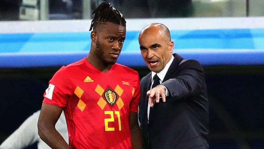 SAINT PETERSBURG, RUSSIA - JULY 10:  Head Coach of Belgium Roberto Martinez talks with Michy Batshuayi of Belgium before introducing him as a substitute during the 2018 FIFA World Cup Russia Semi Final match between Belgium and France at Saint Petersburg Stadium on July 10, 2018 in Saint Petersburg, Russia.  (Photo by Chris Brunskill/Fantasista/Getty Images)