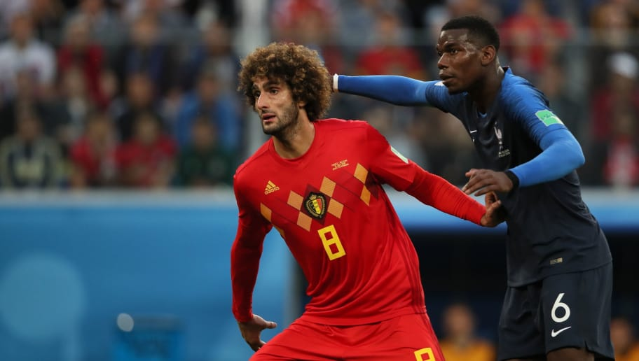 SAINT PETERSBURG, RUSSIA - JULY 10: Marouane Fellaini of Belgium and Paul Pogba of France during the 2018 FIFA World Cup Russia Semi Final match between Belgium and France at Saint Petersburg Stadium on July 10, 2018 in Saint Petersburg, Russia. (Photo by Matthew Ashton - AMA/Getty Images)