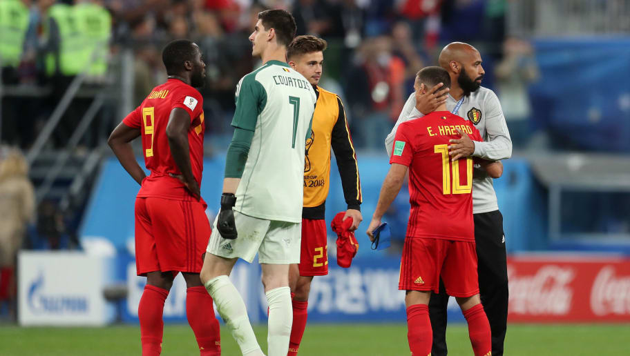 SAINT PETERSBURG, RUSSIA - JULY 10:  Romelu Lukaku, Thibaut Courtois, Leander Dendoncker, Eden Hazard of Belgium and assistant coach Thierry Henry look dejected following their sides defeat in the 2018 FIFA World Cup Russia Semi Final match between Belgium and France at Saint Petersburg Stadium on July 10, 2018 in Saint Petersburg, Russia.  (Photo by Catherine Ivill/Getty Images)