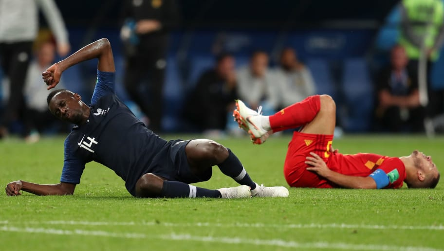SAINT PETERSBURG, RUSSIA - JULY 10:  Eden Hazard of Belgium and Blaise Matuidi of France lie on the pitch injured during the 2018 FIFA World Cup Russia Semi Final match between Belgium and France at Saint Petersburg Stadium on July 10, 2018 in Saint Petersburg, Russia.  (Photo by Catherine Ivill/Getty Images)