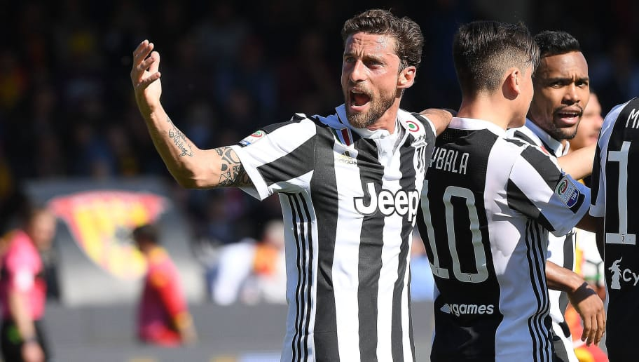 BENEVENTO, ITALY - APRIL 07:  Claudio Marchisio and Paulo Dybala of Juventus celebrate the 0-1 goal scored by Paulo Dybala during the serie A match between Benevento Calcio and Juventus at Stadio Ciro Vigorito on April 7, 2018 in Benevento, Italy.  (Photo by Francesco Pecoraro/Getty Images)