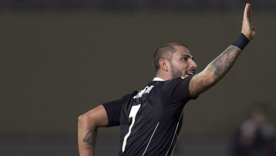 Besiktas midfielder Ricardo Quaresma (R) celebrates after scoring a goal against Maccabi Tel-Aviv during an UEFA Europa League Group E football match at the Bloomfield Stadium in Tel Aviv on December 1, 2011.  AFP PHOTO / JACK GUEZ (Photo credit should read JACK GUEZ/AFP/Getty Images)