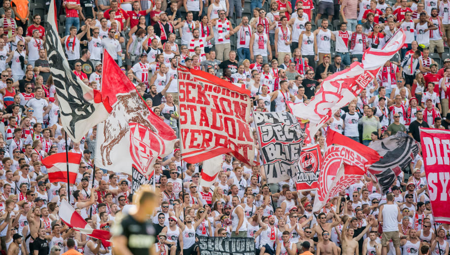 BERLIN, GERMANY - AUGUST 19: Fans of Cologne support their team during the German DFB Cup first round match between BFC Dynamo and 1. FC Koeln at Olympiastadion on August 19, 2018 in Berlin, Germany. (Photo by Thomas Eisenhuth/Getty Images)