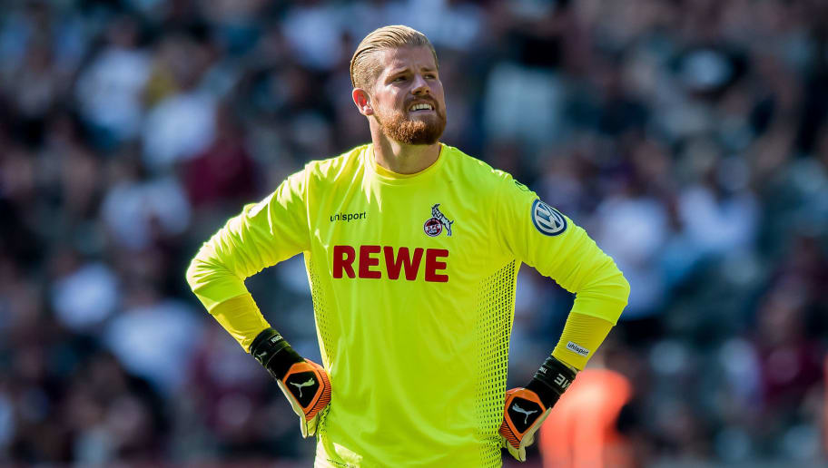 BERLIN, GERMANY - AUGUST 19: Goalkeeper Timo Horn of Cologne reacts during the German DFB Cup first round match between BFC Dynamo and 1. FC Koeln at Olympiastadion on August 19, 2018 in Berlin, Germany. (Photo by Thomas Eisenhuth/Getty Images)