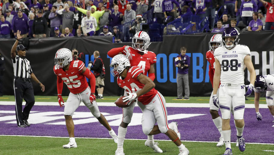 INDIANAPOLIS, INDIANA - DECEMBER 01: Shaun Wade #24 of the Ohio State Buckeyes celebrates with his team after intercepting a pass in the game against the Ohio State Buckeyes in the second quarter at Lucas Oil Stadium on December 01, 2018 in Indianapolis, Indiana. (Photo by Joe Robbins/Getty Images)