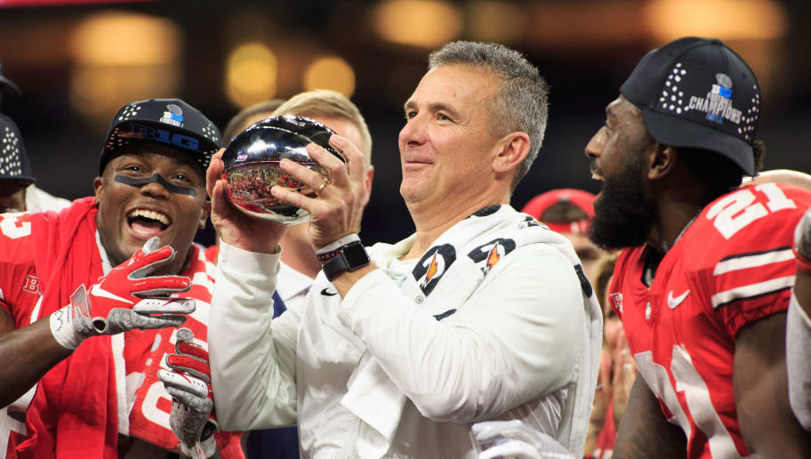 INDIANAPOLIS, IN - DECEMBER 01: Head coach Urban Meyer of the Ohio State Buckeyes holds the Big Ten Championship trophy at Lucas Oil Stadium on December 1, 2018 in Indianapolis, Indiana. (Photo by Justin Casterline/Getty Images)
