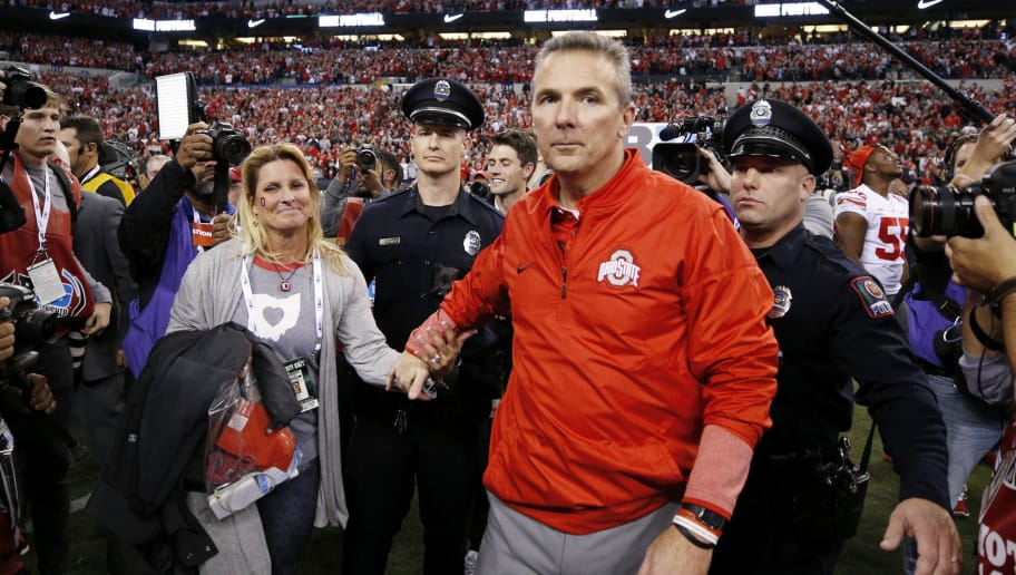 INDIANAPOLIS, IN - DECEMBER 02: Head coach Urban Meyer of the Ohio State Buckeyes celebrates with his wife Shelley following the Big Ten Championship against the Wisconsin Badgers at Lucas Oil Stadium on December 2, 2017 in Indianapolis, Indiana. (Photo by Joe Robbins/Getty Images)