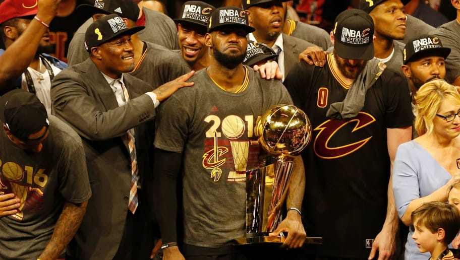 Cleveland Cavaliers forward LeBron James reacts while holding the Larry O'Brien trophy after defeating the Gold State Warriors to win the NBA Finals on June 19, 2016 in Oakland, California. Powered by an amazing effort from LeBron James, the Cleveland Cavaliers completed the greatest comeback in NBA Finals history, dethroning defending champion Golden State 93-89 to capture their first NBA title. The Cavaliers won the best-of-seven series 4-3 to claim the first league crown in their 46-season history and deliver the first major sports champion to Cleveland since the 1964 NFL Browns, ending the longest such title drought for any American city.  / AFP / Beck Diefenbach        (Photo credit should read BECK DIEFENBACH/AFP/Getty Images)