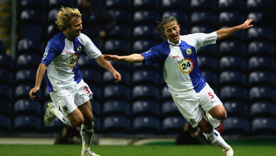 BLACKBURN, UNITED KINGDOM - NOVEMBER 19: Tugay of Blackburn celebrates his goal with team mate Michael Gray during the Barclays Premiership match between Blackburn Rovers and  Tottenham Hotspur at Ewood Park on November 19, 2006 in Blackburn, England  (Photo by Mark Thompson/Getty Images)