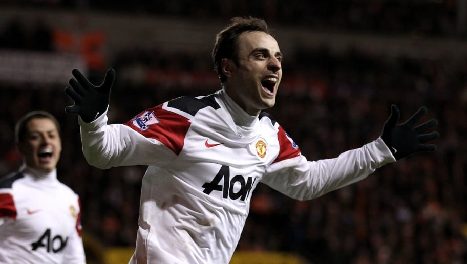 BLACKPOOL, ENGLAND - JANUARY 25:   Dimitar Berbatov of Manchester United celebrates scoring his team's third goal during the Barclays Premier League match between Blackpool and Manchester United at Bloomfield Road on January 25, 2011 in Blackpool, England. (Photo by Alex Livesey/Getty Images)