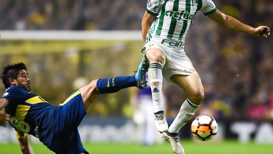 LA BOCA, ARGENTINA - APRIL 25: Diogo Barbosa of Palmeiras is fouled by Pablo Perez of Boca Juniors during a match between Boca Juniors and Palmeiras as part of Copa CONMEBOL Libertadores 2018  at Alberto J. Armando Stadium on April 25, 2018 in Buenos Aires, Argentina. (Photo by Marcelo Endelli/Getty Images)
