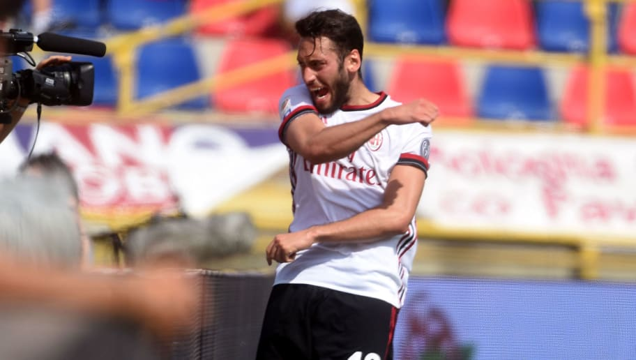 BOLOGNA, ITALY - APRIL 29:  Hakan  Calhanoglu of AC Milan celebrates after scoring the opening goal during the serie A match between Bologna FC and AC Milan at Stadio Renato Dall'Ara on April 29, 2018 in Bologna, Italy.  (Photo by Mario Carlini / Iguana Press/Getty Images)