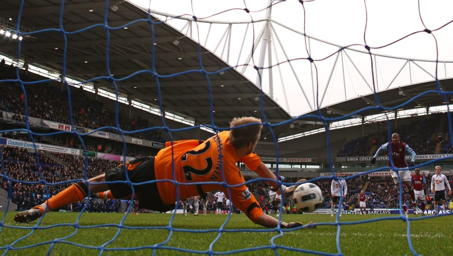 BOLTON, ENGLAND - MARCH 05:  Jussi Jaaskelainen of Bolton Wanderers saves a penalty from Ashley Young of Aston Villa during the Barclays Premier League match between Bolton Wanderers and Aston Villa at the Reebok Stadium on March 5, 2011 in Bolton, England.  (Photo by Alex Livesey/Getty Images)