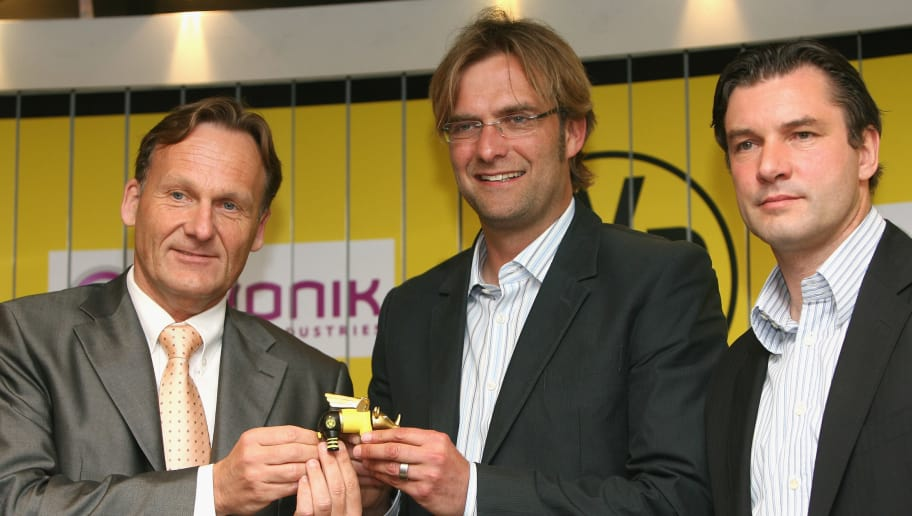 DORTMUND, GERMANY - MAY 23: (L-R) Chairman Hans-Joachim Watzke, new head coach Juergen Klopp and manager Michael Zorc pose after the press conference of the presentation of the new head coach at the Signal Iduna Park on May 23, 2008 in Dortmund, Germany. (Photo by Christof Koepsel/Bongarts/Getty Images)