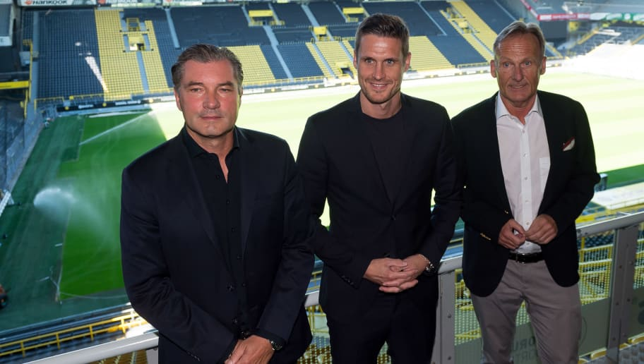 DORTMUND, GERMANY - JULY 03: Sporting director Michael Zorc of Dortmund, Head of the Licensing Player Department Sebastian Kehl of Dortmund and CEO Hans-Joachim Watzke of Dortmund attend the press conference on July 3, 2018 in Dortmund, Germany. (Photo by TF-Images/Getty Images)