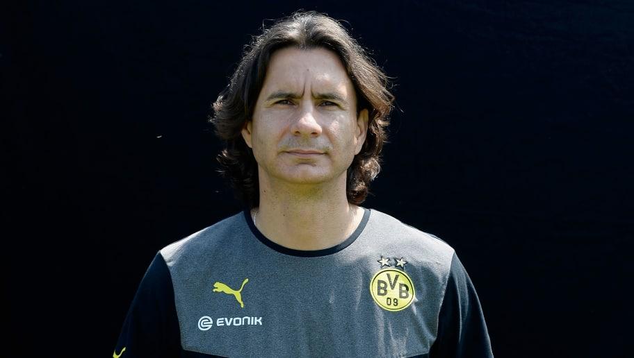 DORTMUND, GERMANY - JULY 09:  Zeljko Buvac poses during the Borussia Dortmund Team Presentation at Brackel Training Ground on July 9, 2013 in Dortmund, Germany.  (Photo by Dennis Grombkowski/Bongarts/Getty Images)