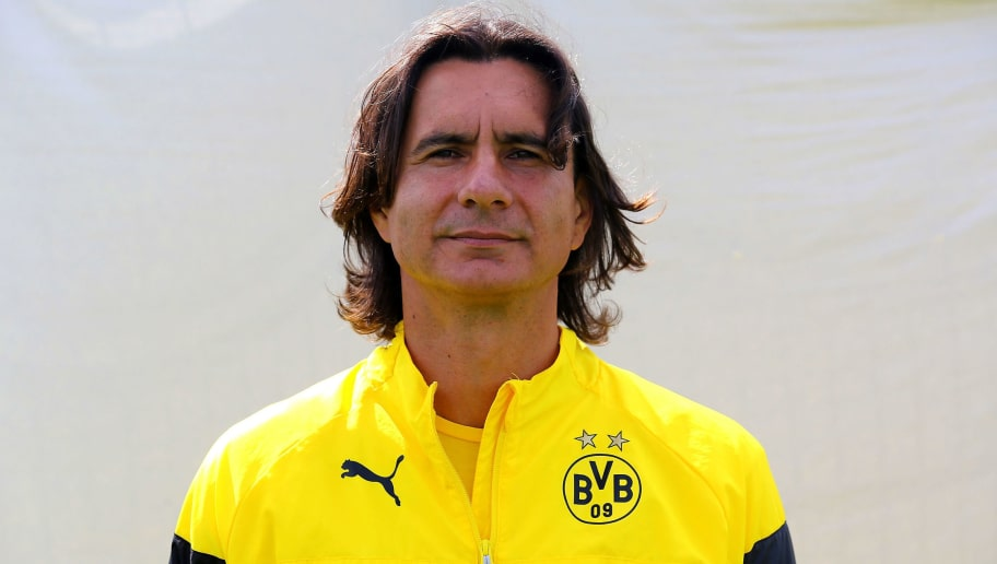 DORTMUND, GERMANY - AUGUST 11:  Assisdtant coach Zeljko Buvac poses during the Borussia Dortmund team presentation at Brackel training ground on August 11, 2014 in Dortmund, Germany.  (Photo by Christof Koepsel/Bongarts/Getty Images)
