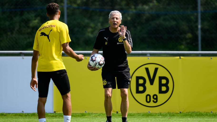 BAD RAGAZ, SWITZERLAND - AUGUST 05: Achraf Hakimi of Dortmund speaks with Head coach Lucien Favre of Dortmund during the Borussia Dortmund training camp on August 5, 2018 in Bad Ragaz, Switzerland. (Photo by TF-Images/Getty Images)