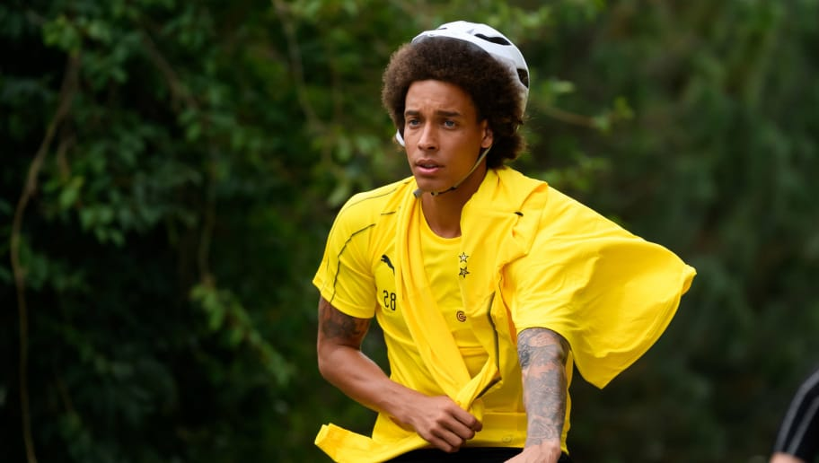 BAD RAGAZ, SWITZERLAND - AUGUST 06: Axel Witsel of Borussia Dortmund rides a bicycle during the Borussia Dortmund training camp on August 6, 2018 in Bad Ragaz, Switzerland. (Photo by TF-Images/Getty Images)