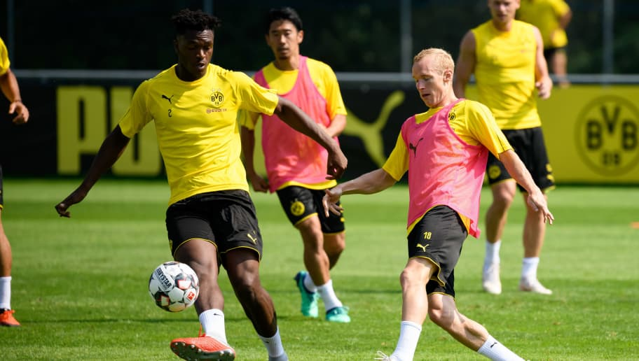 BAD RAGAZ, SWITZERLAND - AUGUST 05: Dan-Axel Zagadou of Dortmund and Sebastian Rode of Dortmund battle for the ball during the Borussia Dortmund training camp on August 5, 2018 in Bad Ragaz, Switzerland. (Photo by TF-Images/Getty Images)