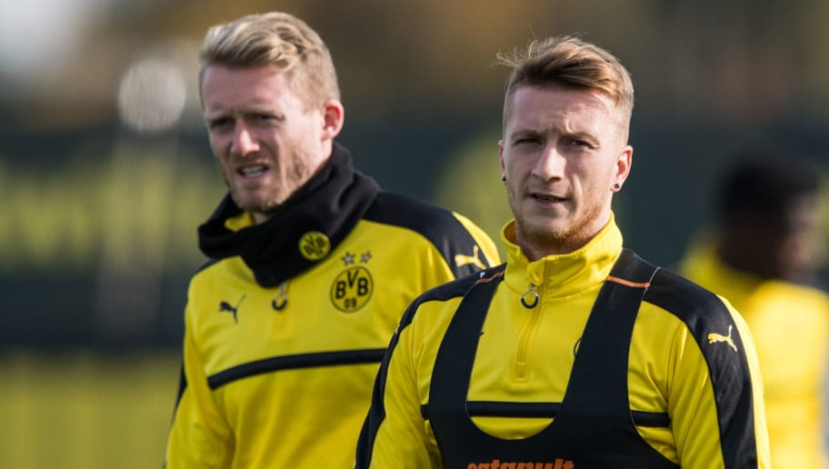 DORTMUND, GERMANY - NOVEMBER 01: Andre Schuerrle of Dortmund (L) and Marco Reus of Dortmund (R) warm up during a training session ahead of their Champions League match against Sporting CP at Dortmund Brackel Training Ground on November 1, 2016 in Dortmund, Germany. (Photo by Lukas Schulze/Bongarts/Getty Images)