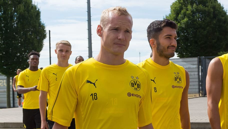DORTMUND, GERMANY - JULY 09: Sebastian Rode of Dortmund, Nuri Sahin of Dortmund and Oemer Toprak of Dortmund look on during a training session at BVB trainings center on July 9, 2018 in Dortmund, Germany. (Photo by TF-Images/Getty Images)