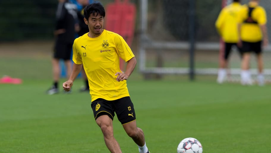 DORTMUND, GERMANY - AUGUST 15: Shinji Kagawa of Borussia Dortmund controls the ball during the Borussia Dortmund training session on August 15, 2018 in Dortmund, Germany. (Photo by TF-Images/Getty Images)