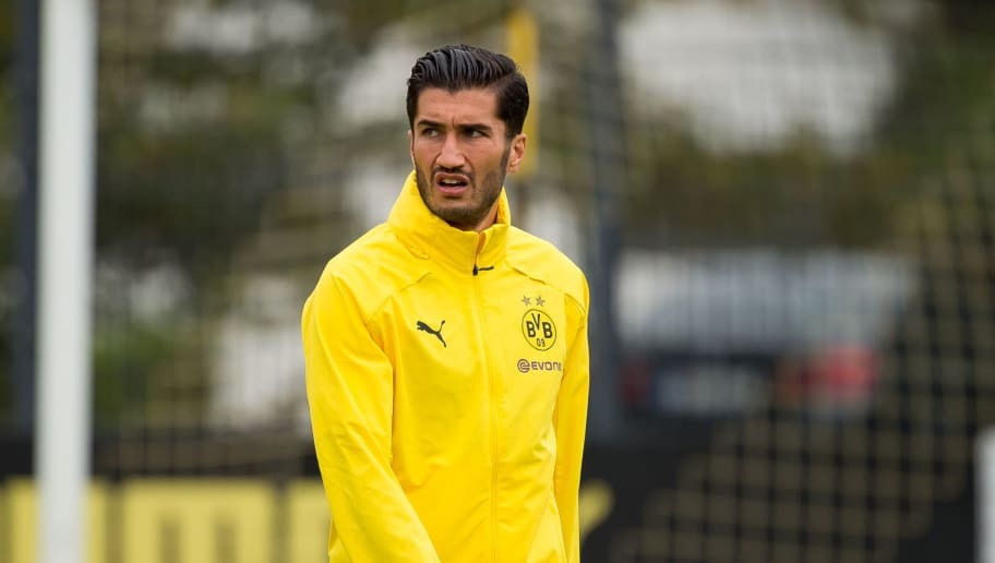 DORTMUND, GERMANY - AUGUST 26: Nuri Sahin of Borussia Dortmund looks on during the Borussia Dortmund training session on August 26, 2018 in Dortmund, Germany. (Photo by TF-Images/Getty Images)