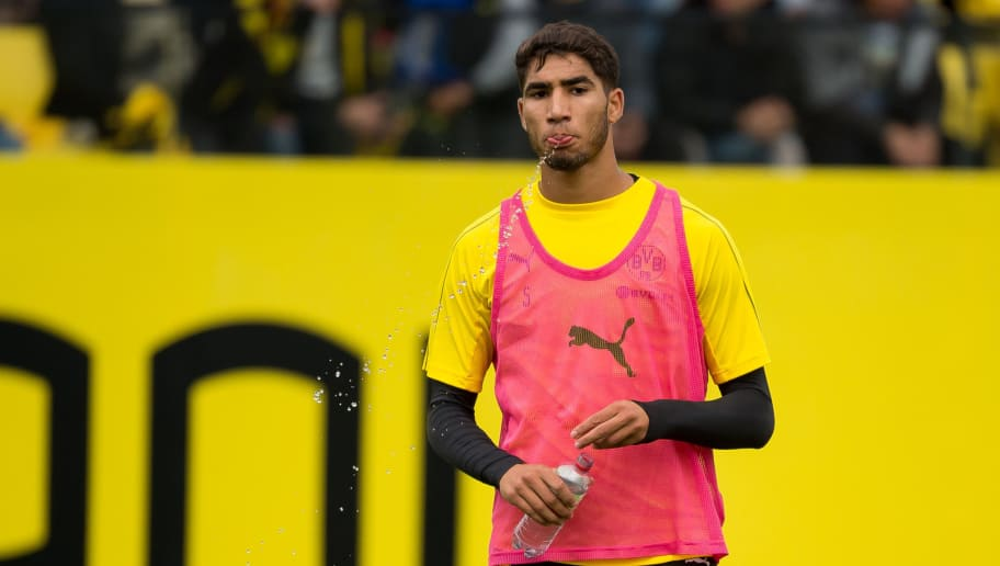 DORTMUND, GERMANY - AUGUST 26: Achraf Hakimi of Borussia Dortmund looks on during the Borussia Dortmund training session on August 26, 2018 in Dortmund, Germany. (Photo by TF-Images/Getty Images)