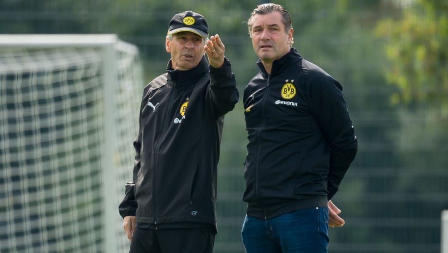 DORTMUND, GERMANY - SEPTEMBER 15: Head coach Lucien Favre of Borussia Dortmund speaks with Sporting director Michael Zorc of Borussia Dortmund during the Borussia Dortmund training session on September 15, 2018 in Dortmund, Germany. (Photo by TF-Images/Getty Images)